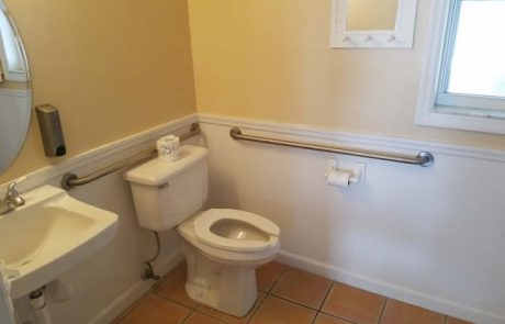 Bathroom in ADA room with grab bars next to the toilet