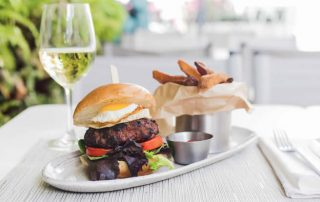 burger & fries with glass of wine