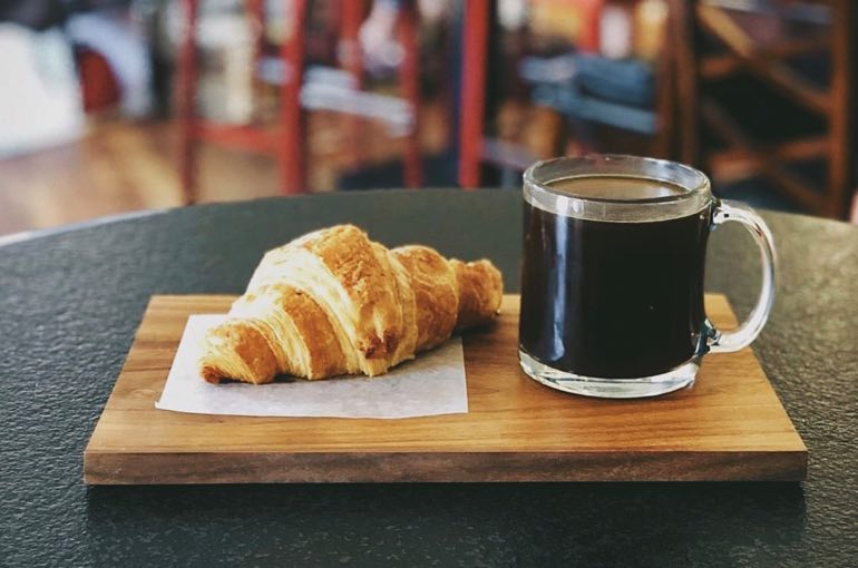 Kunjani Craft Coffee and coissant